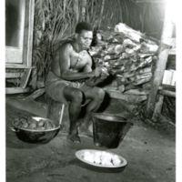 Island mess cook peels potatos [sic]