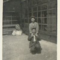 Kaizawa 2-043: Two Japanese people posing in front of…