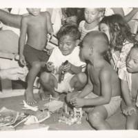 Their initial shyness past, Rongelap children play with…