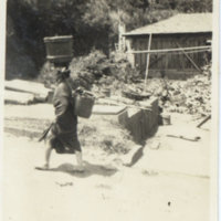 A person carrying baskets on both head and back, Oshima…