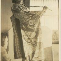 Kaizawa box 13-015: Woman receiving help while trying…