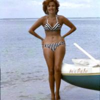 Lady posing on a beach