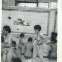 Japanese women and children in a public bath (sento…