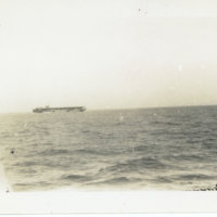 US aircraft carrier at sea in distance, Okinawa