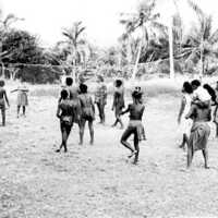 Young people playing volleyball, Yap. (N-2640. 02).