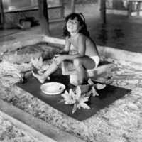 Young Ponapean girl grating coconut. (N-2).