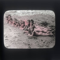 Naked local children prostrate on beach (Waimea, Kauai)
