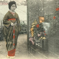 [A woman in kimono standing in the garden, looking at…