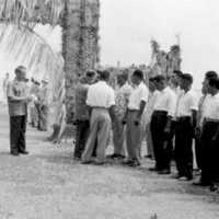 Yap welcomes Washington visitors, 1957. Under arch,…