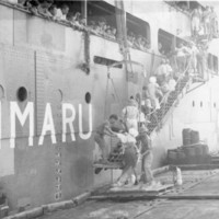 Japanese civilians board transport for Tokyo, Saipan,…