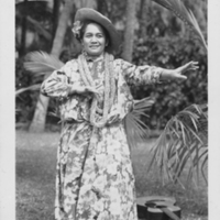 Woman performing hula, most likely Hilo Hattie
