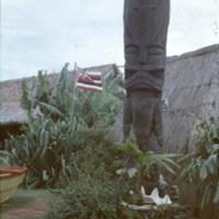 Tiki statue and a Hawaiian flag