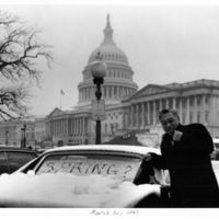Senator Hiram Fong in the snow in front of the Capitol
