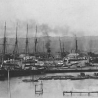 4-masted ship, other boats in harbor