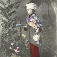 [A girl in kimono holding  a tea set]