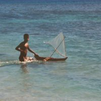 Boy with Toy Canoe in Water