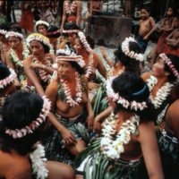 Satawales girls preparing to dance. In the center are…