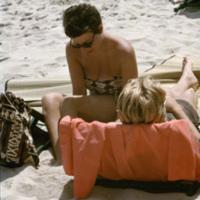Tourists lounging on a beach