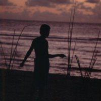 Young Man at Beach at Sunset