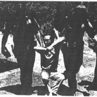 Police arresting a male protestor
