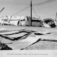 Quonset warehouses destroyed by typhoon. (N- 1886b.17).