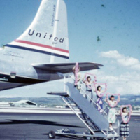 Wahines with leis celebrating 10,000 UAL flt. to…