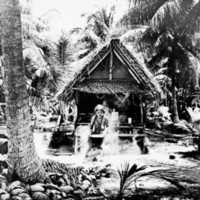 Yapese women cooking on open fire. (N-2626.04).