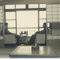 Two American men sitting in a Japanese style room of…