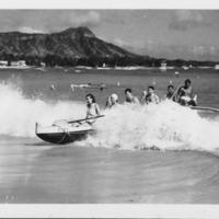 Outrigger canoe in surf at Waikiki Beach
