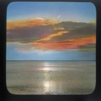 Clouds over ocean, colorized to sunset tones