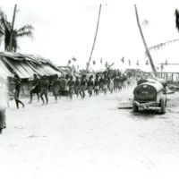 Native Gilbertese work battalion marches off to work…