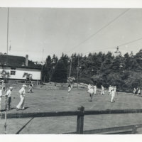 People in a cricket attire playing cricket, Japan
