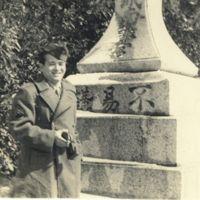 Kaizawa 2-020: Ken Oshiro standing in front of the…