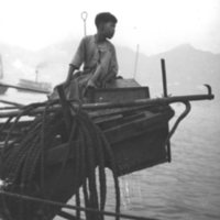 055. Boat boy on stern of fishing vessel