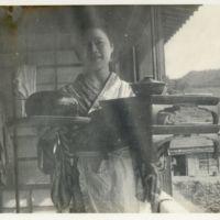 Kaizawa 2-118: Female hotel worker in kimono carrying…