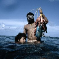 Man and Child with Caught Reef Fish