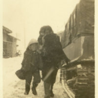 A Japanese woman with a boy in heavy snow next to a…