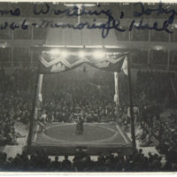 A referee awarding a decision to the winner at Sumo…