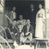 A Caucasian man surrounded by four Japanese men and one…