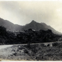 Paved road with mountains in distance