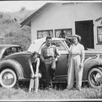 2 Women and a Man posing In Front of a Convertible Car…