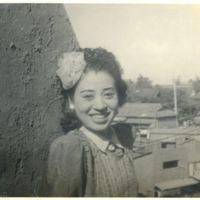 Kaizawa 2-092: Japanese woman posing with city…