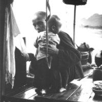 078b. Boatman and child, Fu River