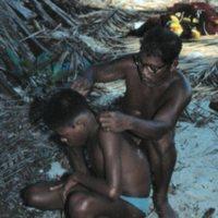 Man Cutting Boy's Hair