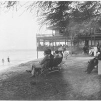 Beachgoers Sitting on Benches