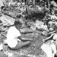 Close-up of Okau men meeting with magistrate, 1969.…