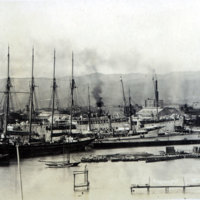 Honolulu Harbor with 4-masted sailboat in foreground