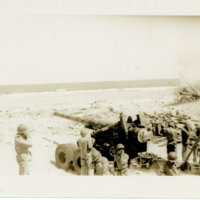 American soldiers shooting an artillery gun from the…