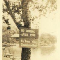 Kaizawa 2-058: Image of sign posted on a tree at a lake…