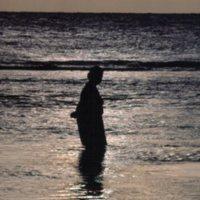 Person Standing in Ocean
